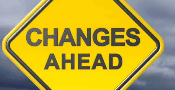 "yellow diamond-shaped sign with the words ""changes ahead"" in black"